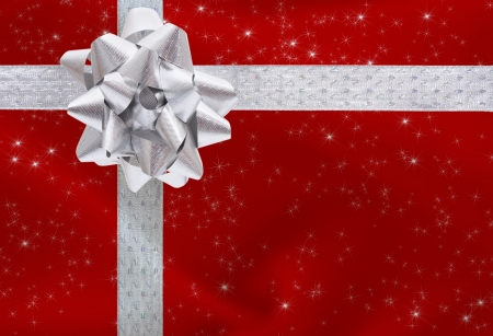 gift wrap: A ribbon and bow on a red background with copy space Stock Photo