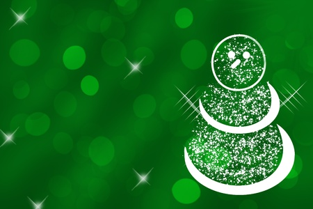 A white glitter snowman on a green background, Christmas Time photo