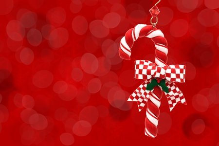 A candy cane on a red background, candy cane background photo