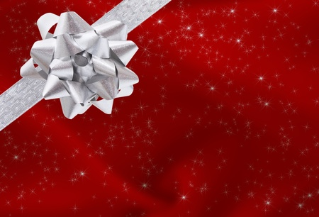 A ribbon and bow on a red background, christmas present background Stock Photo - 8366510
