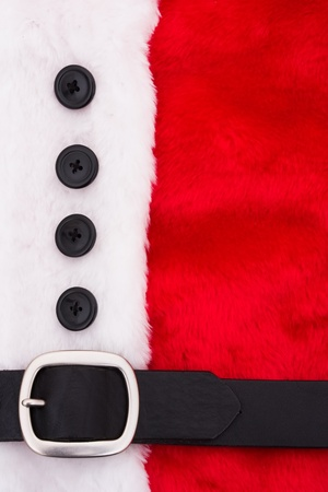 A close up of a santa suit, santa suit background photo