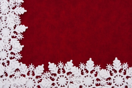 A white snowflake border on a red background, winter time 版權商用圖片
