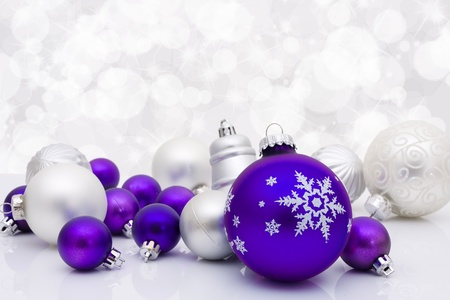 silver bells: Purple christmas balls on a sparkle background, christmas time