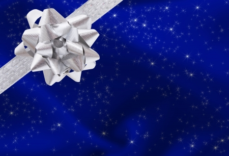A ribbon and bow on a blue background, christmas present background Foto de archivo