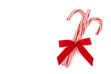 candy cane: Three candy canes on a white background, candy cane background