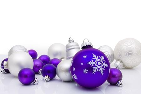 silver ribbon: Purple christmas balls on a white background, christmas time Stock Photo