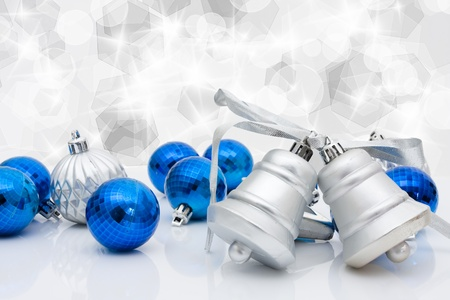 christmas time: Blue christmas balls and bells on a sparkle background, christmas time