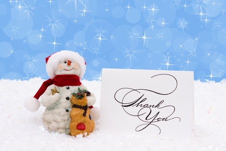 thank you card: A snowman with a thank you card on a snow background, Winter time Stock Photo