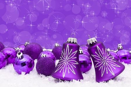 christmas decorations: Purple christmas balls on a snow and purple background, christmas time Stock Photo
