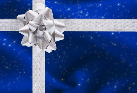 A ribbon and bow on a blue background, christmas present photo