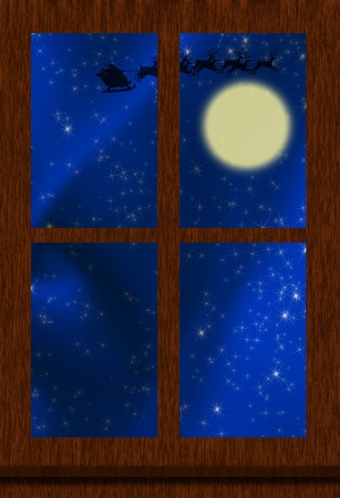 A window with santa in flight over a full moon, christmas eve photo