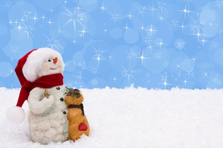 A snowman on a blue background, Winter Time photo