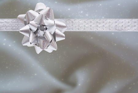 A ribbon and bow on a silver background, christmas present background photo