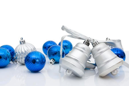 silver ribbon: Blue christmas balls and bells on a white background, christmas time Stock Photo