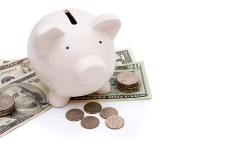 A piggy bank with money isolated on a white background, savings Banco de Imagens