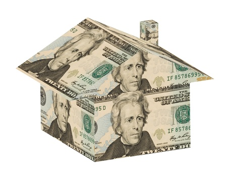 home repairs: A house made out of money on a white background, money house
