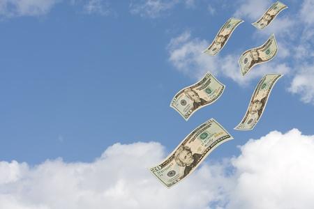Twenty dollar bills floating through a cloudy sky, Raining Money photo