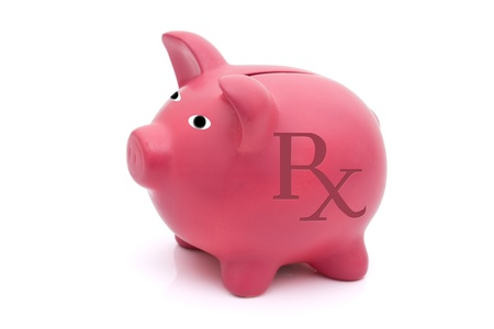 A pink piggy bank with a prescription symbol on a white background, Cost of healthcare Stock Photo - 8795797