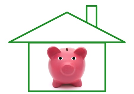 A green outline of a house with a piggy bank, home savings photo