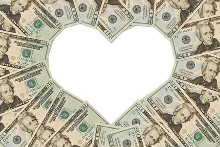 dinero: Billetes de d�lar veinte haciendo un s�mbolo del coraz�n sobre un fondo blanco, coraz�n de dinero Foto de archivo