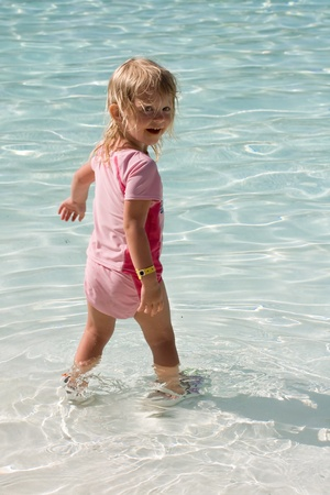 Toddler girl swimming in a pool , Happy Summer Days photo