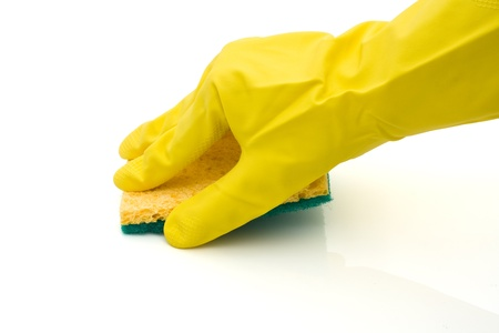 A green and yellow scrubbing sponge with a hand and latex gloves isolated on white,  Cleaning Time Stock Photo