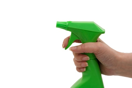 A green spray bottle with a hand isolated on white,  Cleaning Time photo