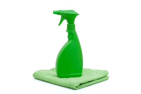 A green spray bottle with a green towel isolated on white,  Cleaning Time