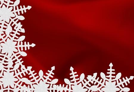 A white snowflake border on a red background, winter time Archivio Fotografico