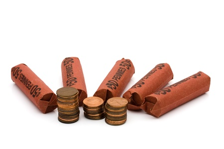 A lot of pennies with rolls of pennies isolated on white, Having a lot of money spare change Imagens
