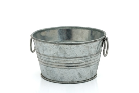 Empty old fashion silver bucket isolated on white photo