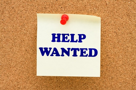 A note on a corkboard with the words helped wanted Stock Photo - 9542937