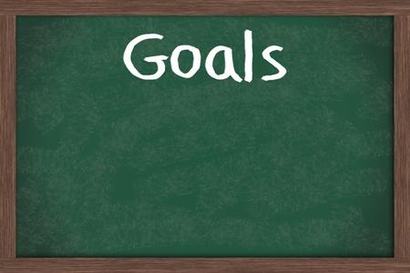 doelen: Het schrijven van uw doelstellingen naar beneden op een schoolbord, zakelijke of persoonlijke doelen Stockfoto