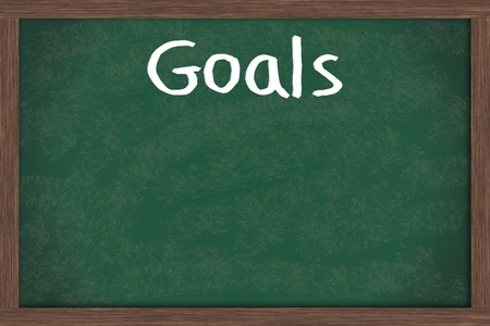 education goals: Writing your goals down on a blackboard, business or personal goals