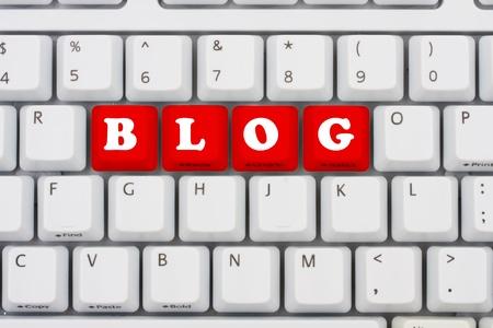 inform information: Computer keyboard keys displaying the word blog in red, Blogging on the internet
