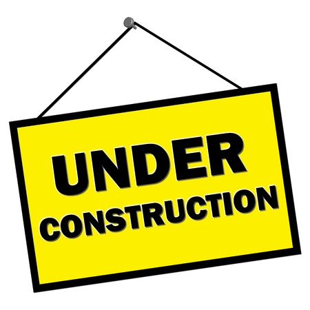 site: Under construction sign hanging from nail isolated over white