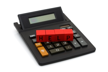 A black calculator with blocks spelling help isolated on white, Help with your finances Stock Photo - 9579879