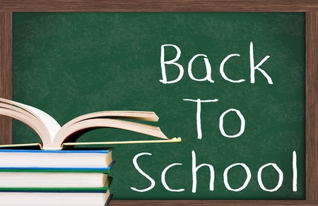 Stack of  books one open in front of the chalkboard, Back to School Stock Photo - 9622070