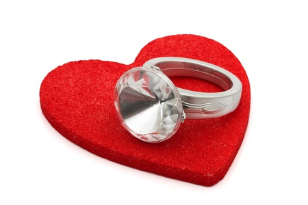 diamond shaped: Diamond ring on a red shaped heart isolated on white, Giving a diamond ring