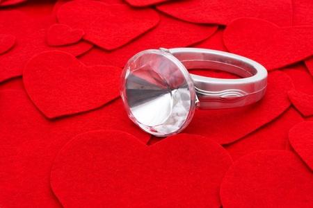 diamond shaped: Diamond ring on a red shaped heart background, diamond ring