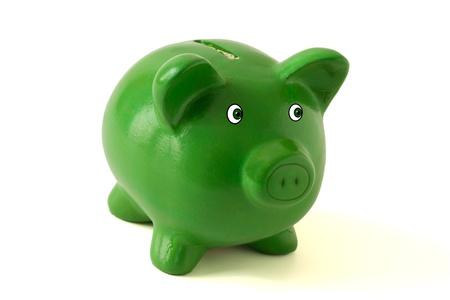 Een groene piggy bank op een witte achtergrond, besparingen Stockfoto