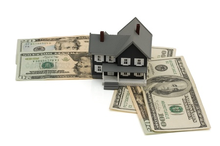 House sitting on some American money isolated on white, Mortgage payment Stock Photo - 9882544