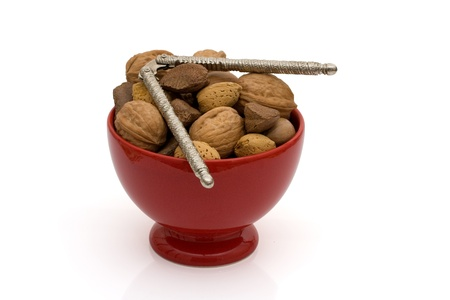A bowl of healthy nuts in shell isolated on white, healthy eating Stock Photo - 9882550