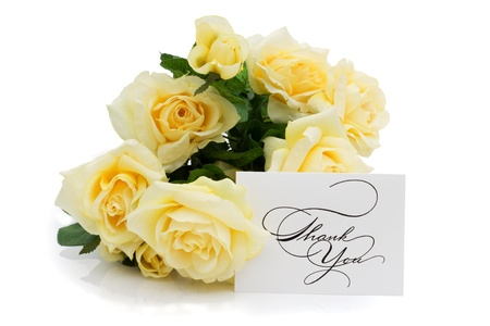 A yellow bouquet of rose with a thank you note isolated on white, Thank you photo