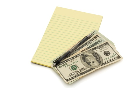 A notepad and pen with some American money isolated on white, Budgeting your money Stock Photo - 9882592