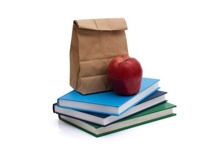 school lunch: A lunch bag with an apple and books isolated on white, Healthy School Lunch