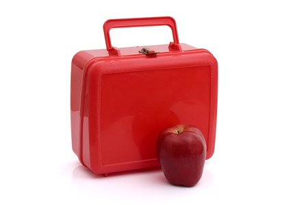 A red lunchbox with an apple isolated on white, Healthy School Lunch Stock Photo