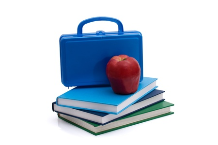 A blue lunchbox with an apple and books isolated on white, Healthy School Lunch photo