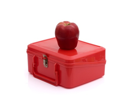 A red lunchbox with an apple isolated on white, Healthy School Lunch photo