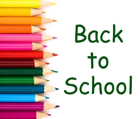 Back to school with pencil crayons border isolated on white, a school background photo